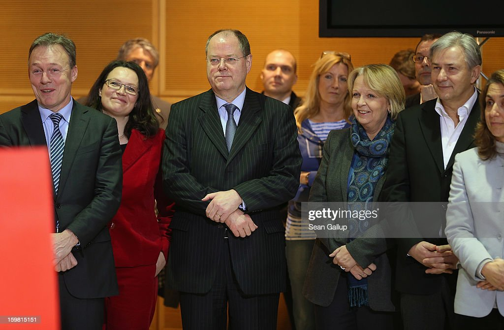 <a gi-track='captionPersonalityLinkClicked' href=/galleries/search?phrase=Peer+Steinbrueck&family=editorial&specificpeople=209110 ng-click='$event.stopPropagation()'>Peer Steinbrueck</a> (C), chancellor candidate for the German Social Democrats (SPD), looks on as SPD Chairman Sigmar Gabriel and Stephan Weil, SPD gubernatorial candidate in Lower Saxony (both not pictured), speak at SPD headquarters the day after the SPD and German Greens party emerged with a hairline victory in Lower Saxony on January 21, 2013 in Berlin, Germany. The win has given the SPD a much needed boost following declining popularity figures for Steinbrueck. Germany faces national elections later this year.