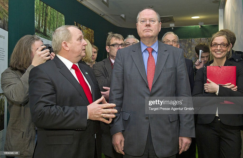 <a gi-track='captionPersonalityLinkClicked' href=/galleries/search?phrase=Peer+Steinbrueck&family=editorial&specificpeople=209110 ng-click='$event.stopPropagation()'>Peer Steinbrueck</a>, chancellor candidate for the German Social Democrats (SPD), tours the 2013 Gruene Woche agricultural trade fair on January 25, 2013 in Berlin, Germany. Steinbrueck is the main opposite candidate to face German Chancellor and Christian Democrat Angela Merkel in elections scheduled for later this year, though his popularity tatings have dropped significantly in recent month.