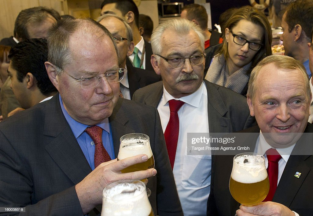 <a gi-track='captionPersonalityLinkClicked' href=/galleries/search?phrase=Peer+Steinbrueck&family=editorial&specificpeople=209110 ng-click='$event.stopPropagation()'>Peer Steinbrueck</a>, chancellor candidate for the German Social Democrats (SPD), tours the 2013 Gruene Woche agricultural trade fair on January 25, 2013 in Berlin, Germany. Steinbrueck is the main opposite candidate to face German Chancellor and Christian Democrat Angela Merkel in elections scheduled for later this year, though his popularity ratings have dropped significantly in recent month.