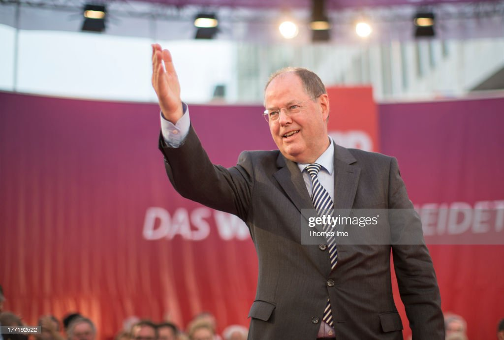 <a gi-track='captionPersonalityLinkClicked' href=/galleries/search?phrase=Peer+Steinbrueck&family=editorial&specificpeople=209110 ng-click='$event.stopPropagation()'>Peer Steinbrueck</a>, chancellor candidate of German social democratic (SPD), delivers a speech during his election campaign on August 21, 2013 in Hannover, Germany. Steinbrueck is on a three-day election campaign trip to the north of Germany. He is trailing incumbent Chancellor Angela Merkel and the German Christian Democrats (CDU) significantly ahead of federal elections scheduled for September 22.
