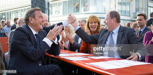 Peer Steinbrueck chancellor candidate of German social democratic and former german chancellor Gerhard Schroeder are pictured during a election...
