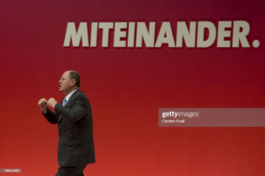 <a gi-track='captionPersonalityLinkClicked' href=/galleries/search?phrase=Peer+Steinbrueck&family=editorial&specificpeople=209110 ng-click='$event.stopPropagation()'>Peer Steinbrueck</a>, chancellor candidate of the German Social Democrats (SPD), rejoices after his speach at the the SPD federal party convention on December 9, 2012 in Hanover, Germany. The SPD is convening to set its policy course for the next year and to celebrate Steinbrueck, who will run for chancellor in elections set for 2013.