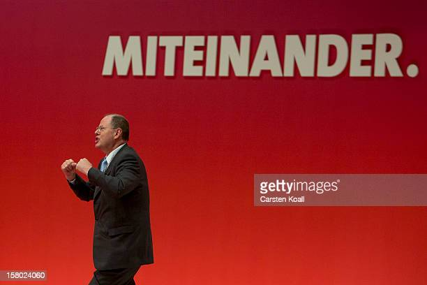 Peer Steinbrueck chancellor candidate of the German Social Democrats rejoices after his speach at the the SPD federal party convention on December 9...