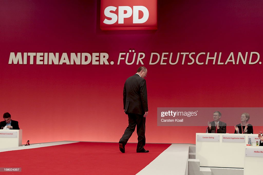 <a gi-track='captionPersonalityLinkClicked' href=/galleries/search?phrase=Peer+Steinbrueck&family=editorial&specificpeople=209110 ng-click='$event.stopPropagation()'>Peer Steinbrueck</a>, chancellor candidate of the German Social Democrats (SPD), attends at the the SPD federal party convention on December 9, 2012 in Hanover, Germany. The SPD is convening to set its policy course for the next year and to celebrate Steinbrueck, who will run for chancellor in elections set for 2013.
