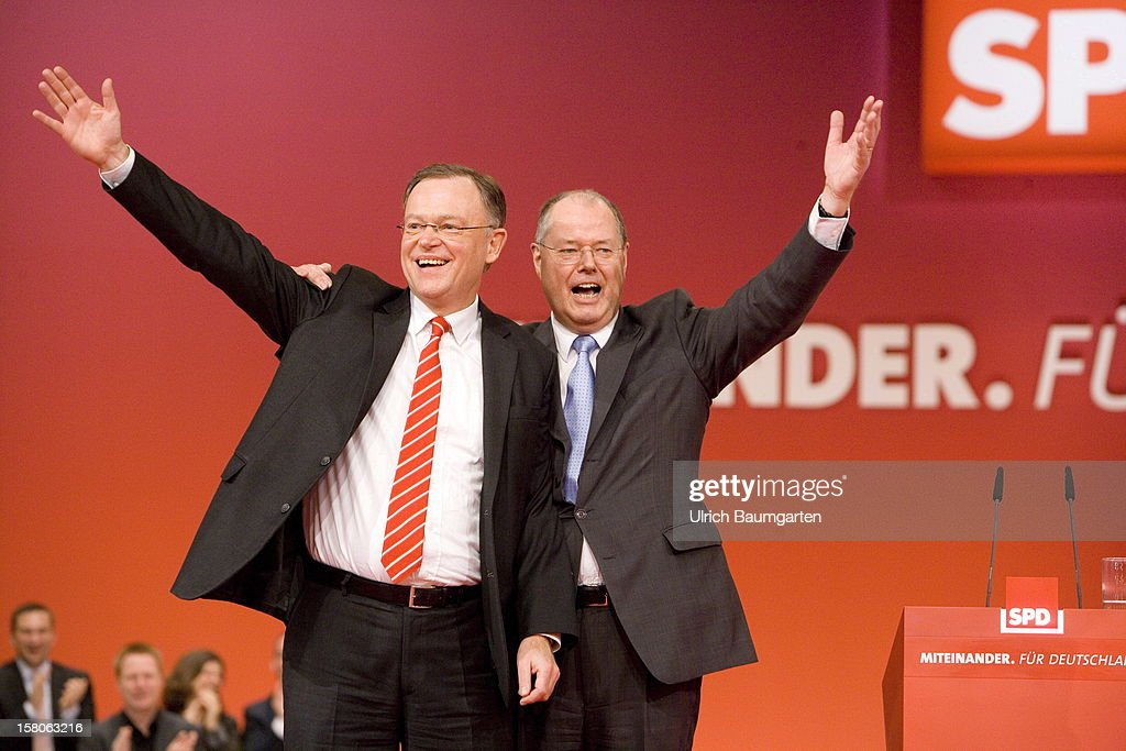 Peer Steinbrueck, chancellor candidate of the German Social Democrats (SPD), after his speech at the SPD federal party convention on December 9, 2012 in Hanover, Germany. Next to him Stephan Weil (SPD), leading candidate for the state election in Lower Saxony. The SPD is convening to set its policy course for the next year and to celebrate Steinbrueck, who will run for chancellor in elections set for 2013.