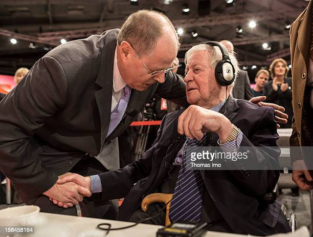 Peer Steinbrueck chancellor candidate of the German Social Democrats shakes hands with former federal chancellor Helmut Schmidt after his speech at...