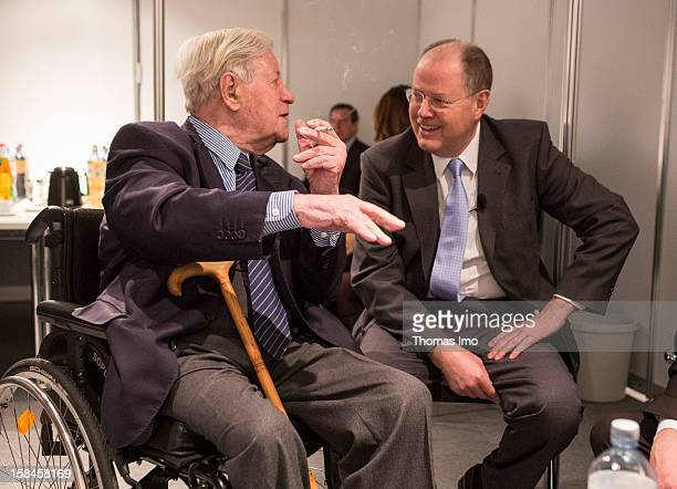 Peer Steinbrueck chancellor candidate of the German Social Democrats talks with former federal chancellor Helmut Schmidt before beginning of the SPD...