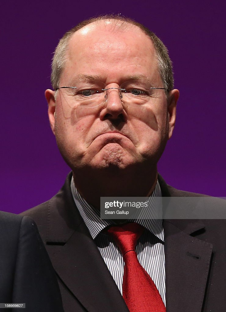 <a gi-track='captionPersonalityLinkClicked' href=/galleries/search?phrase=Peer+Steinbrueck&family=editorial&specificpeople=209110 ng-click='$event.stopPropagation()'>Peer Steinbrueck</a>, chancellor candidate of the German Social Democrats (SPD), attends a Lower Saxony SPD state election rally on January 4, 2013 in Emden, Germany. Lower Saxony is holding state elections on January 20 and many analysts see the election as a bellwether for national elections, in which Steinbrueck will run for chancellor, scheduled to take place later this year.