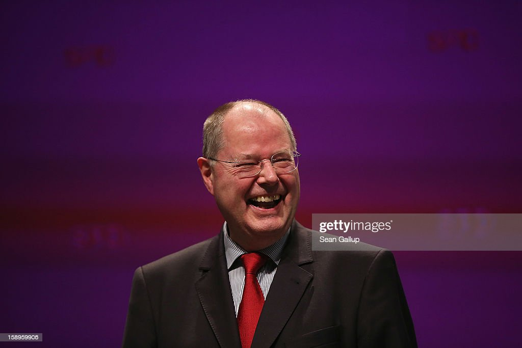 <a gi-track='captionPersonalityLinkClicked' href=/galleries/search?phrase=Peer+Steinbrueck&family=editorial&specificpeople=209110 ng-click='$event.stopPropagation()'>Peer Steinbrueck</a>, chancellor candidate of the German Social Democrats (SPD), laughs after speaking at a Lower Saxony SPD state election rally on January 4, 2013 in Emden, Germany. Lower Saxony is holding state elections on January 20 and many analysts see the election as a bellwether for national elections, in which Steinbrueck will run for chancellor, scheduled to take place later this year.