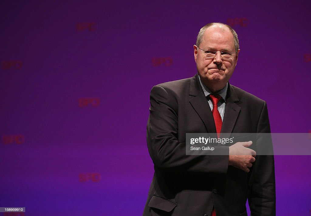 <a gi-track='captionPersonalityLinkClicked' href=/galleries/search?phrase=Peer+Steinbrueck&family=editorial&specificpeople=209110 ng-click='$event.stopPropagation()'>Peer Steinbrueck</a>, chancellor candidate of the German Social Democrats (SPD), gestures after speaking at a Lower Saxony SPD state election rally on January 4, 2013 in Emden, Germany. Lower Saxony is holding state elections on January 20 and many analysts see the election as a bellwether for national elections, in which Steinbrueck will run for chancellor, scheduled to take place later this year.