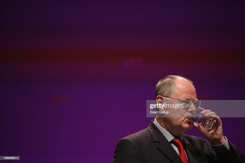 Peer Steinbrueck, chancellor candidate of the German Social Democrats (SPD), drinks from a glass of water after speaking at a Lower Saxony SPD state election rally on January 4, 2013 in Emden, Germany. Lower Saxony is holding state elections on January 20 and many analysts see the election as a bellwether for national elections, in which Steinbrueck will run for chancellor, scheduled to take place later this year.
