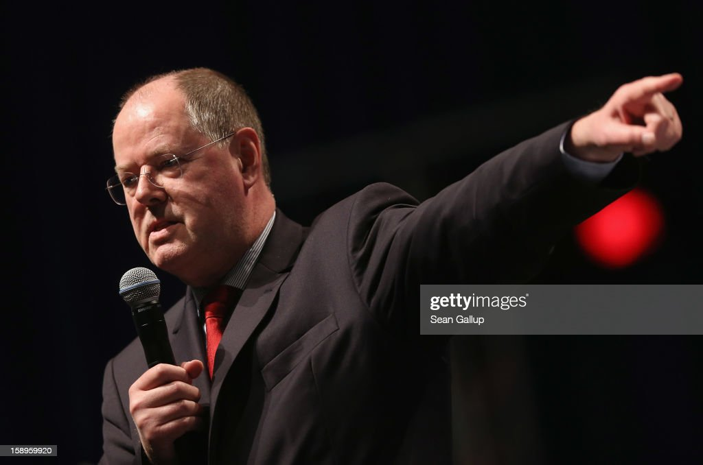 <a gi-track='captionPersonalityLinkClicked' href=/galleries/search?phrase=Peer+Steinbrueck&family=editorial&specificpeople=209110 ng-click='$event.stopPropagation()'>Peer Steinbrueck</a>, chancellor candidate of the German Social Democrats (SPD), speaks at a Lower Saxony SPD state election rally on January 4, 2013 in Emden, Germany. Lower Saxony is holding state elections on January 20 and many analysts see the election as a bellwether for national elections, in which Steinbrueck will run for chancellor, scheduled to take place later this year.