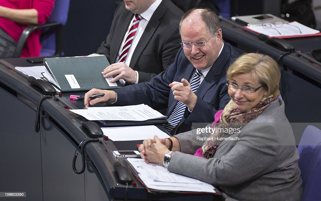 Peer Steinbrueck (L), chancellor candidate of the German Social Democrats (SPD), and Petra Ernstberger (R), MP SPD, during a debate on the Annual Economic Report 2013 of the Federal Government at Reichstag, the seat of the German Parliament (Bundestag), on January 17, 2013 in Berlin, Germany. German Economics Minister Philipp Roesler warned that a short-term deal with the euro crisis through inflation, stating that it's not 'A price we are not willing to pay - the price of monetary stability' in his inaugural speech to the annual economic report in parliament. Merkel's Christian Democratic Union (CDU) will face an electoral test this Sunday as voters go to the polls in Lower Saxony.