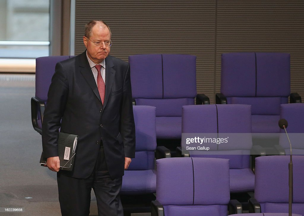Peer Steinbrueck, chancellor candidate of the German Social Democrats (SPD) arrives to hear German Chancellor Angela Merkel give a government declaration on the forthcoming European Union budget that was agreed upon at a summit in Brussels recently on February 21, 2013 in Berlin, Germany. The budget required wrangling and compromises and will give more money to economically-stricken member state.Germany faces federal elections later this year.