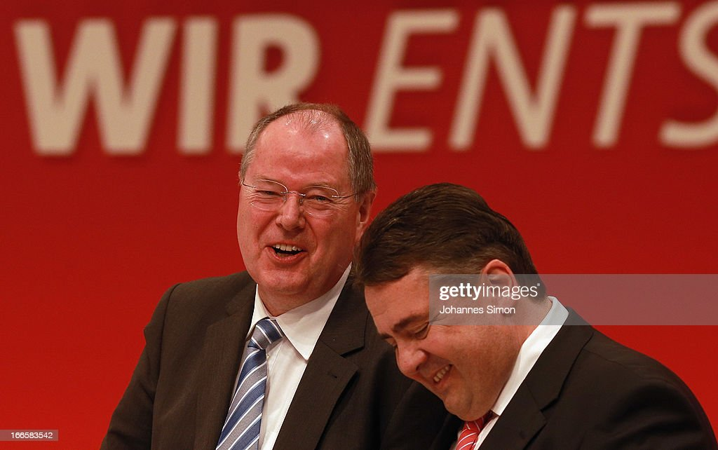 Peer Steinbrueck (L), chancellor candidate of the German Social Democrats (SPD), and Sigmar Gabriel, head of the SPD, laugh at the SPD federal party congress on April 14, 2013 in Augsburg, Germany. Steinbrueck will face Chancellor and Christian Democrat (CDU) Angela Merkel in federal elections scheduled for September. So far Steinbrueck's ratings in the polls have lagged far behind those of Merkel following several comments and gaffes on Steinbrueck's part.