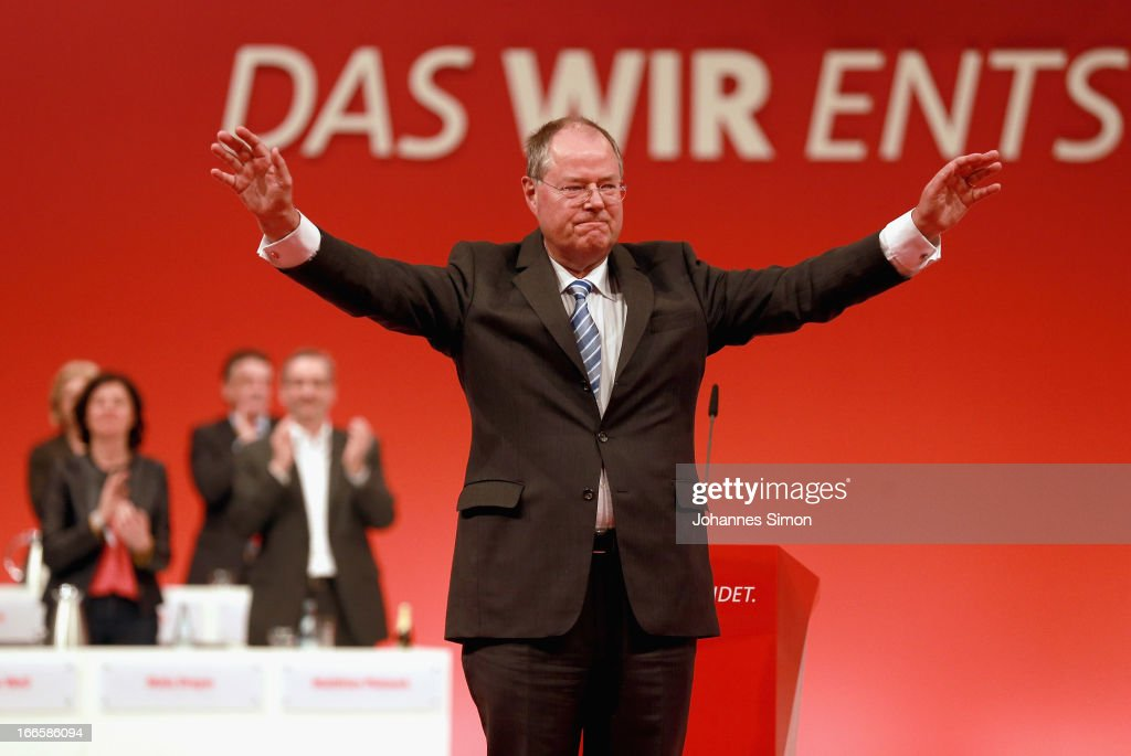 <a gi-track='captionPersonalityLinkClicked' href=/galleries/search?phrase=Peer+Steinbrueck&family=editorial&specificpeople=209110 ng-click='$event.stopPropagation()'>Peer Steinbrueck</a>, chancellor candidate of the German Social Democrats (SPD), reacts after speaking at the SPD federal party congress on April 14, 2013 in Augsburg, Germany. Steinbrueck will face Chancellor and Christian Democrat (CDU) Angela Merkel in federal elections scheduled for September. So far Steinbrueck's ratings in the polls have lagged far behind those of Merkel following several comments and gaffes on Steinbrueck's part.