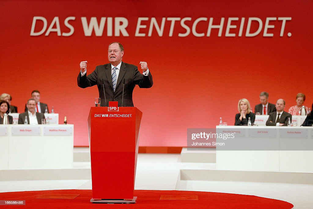 <a gi-track='captionPersonalityLinkClicked' href=/galleries/search?phrase=Peer+Steinbrueck&family=editorial&specificpeople=209110 ng-click='$event.stopPropagation()'>Peer Steinbrueck</a>, chancellor candidate of the German Social Democrats (SPD), speaks at the SPD federal party congress on April 14, 2013 in Augsburg, Germany. Steinbrueck will face Chancellor and Christian Democrat (CDU) Angela Merkel in federal elections scheduled for September. So far Steinbrueck's ratings in the polls have lagged far behind those of Merkel following several comments and gaffes on Steinbrueck's part.