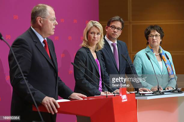 Peer Steinbrueck chancellor candidate of the German Social Democrats presents members of his election campaign competency team including Manuela...