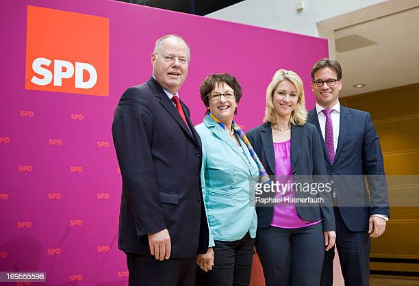 Peer Steinbrueck chancellor candidate of the German Social Democrats presents members of his election campaign competency team including Brigitte...