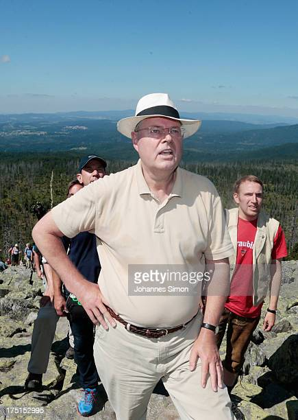 Peer Steinbrueck chancellor candidate of the German Social Democrats hikes up to the summit of Lusen Mountain in Bayerischer Wald national park on...