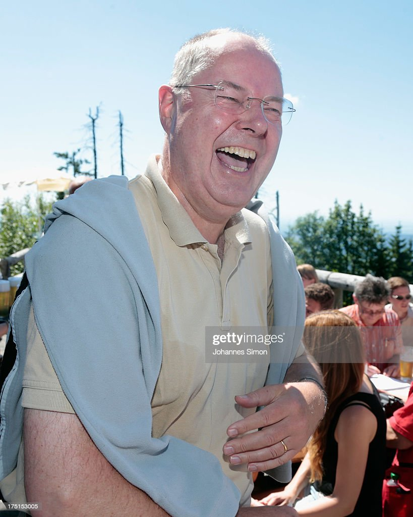 <a gi-track='captionPersonalityLinkClicked' href=/galleries/search?phrase=Peer+Steinbrueck&family=editorial&specificpeople=209110 ng-click='$event.stopPropagation()'>Peer Steinbrueck</a>, chancellor candidate of the German Social Democrats (SPD), laughs during a hiking tour up to the summit of Lusen Mountain in Bayerischer Wald national park on August 01, 2013 near Neuschoenau, Germany. Steinbrueck is so far lagging behind in the polls against German Chancellor and Christian Democrat (CDU) Angela Merkel. Germany is scheduled to hold federal elections on September 22.