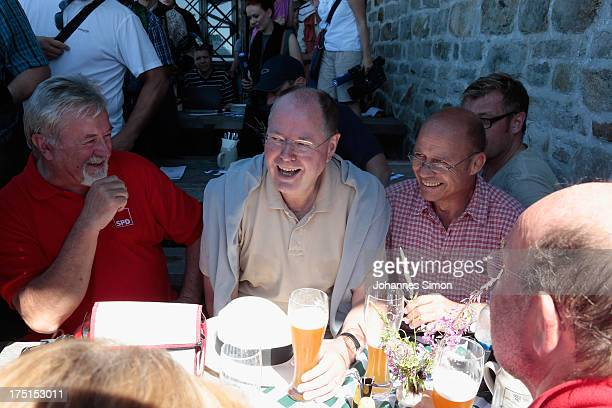 Peer Steinbrueck chancellor candidate of the German Social Democrats chats with supportersduring a hiking tour up to the summit of Lusen Mountain in...
