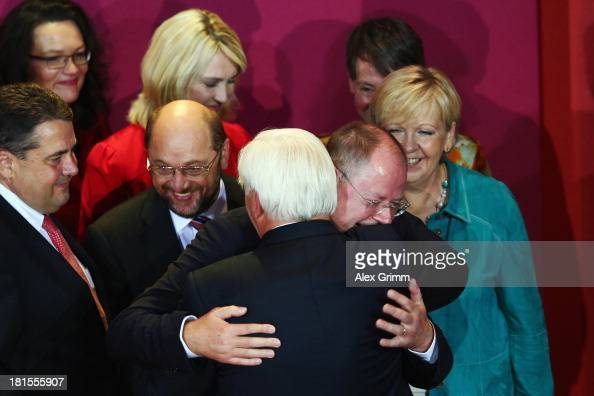 Peer Steinbrueck chancellor candidate of the German Social Democrats is hugged by SPD Bundestag faction leader FrankWalter Steinmeier after initial...