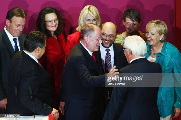 Peer Steinbrueck chancellor candidate of the German Social Democrats is surrounded by leading fellow party members after initial exit poll results...