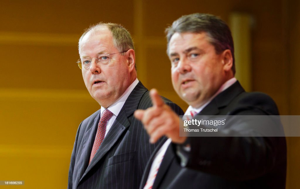 Peer Steinbrueck, (L) chancellor candidate of the German Social Democrats (SPD), and SPD Chairman Sigmar Gabriel arrive for a meeting of the SPD governing board on the first day after German federal elections on September 23, 2013 in Berlin, Germany. The SPD, with 25.7%, finished second behind the German Christian Democrats (CDU), who finished with 41.5% of the vote, which puts the CDU just shy of a majority of seats in the Bundestag. The CDU will now face the task of finding a coalition partner, which is complicated by the failure of its current partner, the German Free Democrats (FDP), to stay above the 5% necessary to retain its Bundestag seats, and many analysts favour a grand coalition between the CDU and the SPD.