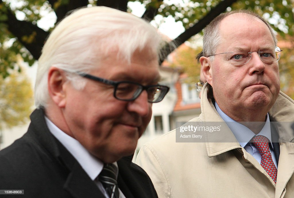 <a gi-track='captionPersonalityLinkClicked' href=/galleries/search?phrase=Peer+Steinbrueck&family=editorial&specificpeople=209110 ng-click='$event.stopPropagation()'>Peer Steinbrueck</a>, former German federal finance minister and the German Social Democrat party's candidate for chancellor in the country's 2013 general elections (R), stands next to <a gi-track='captionPersonalityLinkClicked' href=/galleries/search?phrase=Frank-Walter+Steinmeier&family=editorial&specificpeople=603500 ng-click='$event.stopPropagation()'>Frank-Walter Steinmeier</a>, the German Social Democrat party's Bundestag faction leader, as they arrive at a cemetery to visit the grave of Willy Brandt, former chancellor of the Federal Republic of Germany and Nobel Peace Prize winner, on October 8, 2012 in Berlin, Germany. Brandt was born on December 18, 1913 in Luebeck and died 20 years ago today. He led the SPD from 1964 to 1987 and was chancellor of West Germany from 1969 to 1974, a post from which he resigned after it was revealed that one of his closest aides worked as an agent of the East German secret service, or Stasi. For his efforts to achieve reconciliation between West Germany and the countries of the Soviet bloc, Brandt won the Nobel Prize for Peace in 1971.