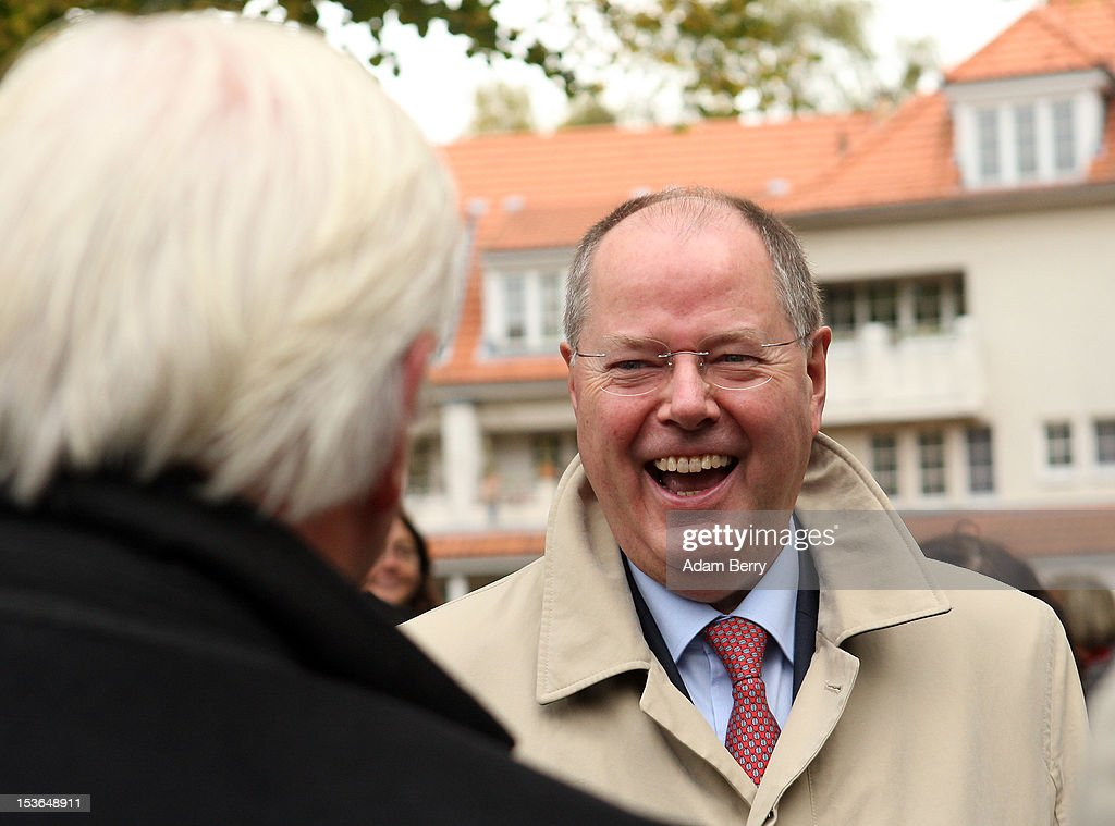 <a gi-track='captionPersonalityLinkClicked' href=/galleries/search?phrase=Peer+Steinbrueck&family=editorial&specificpeople=209110 ng-click='$event.stopPropagation()'>Peer Steinbrueck</a>, former German federal finance minister and the German Social Democrat party's candidate for chancellor in the country's 2013 general elections, reacts as he speaks to <a gi-track='captionPersonalityLinkClicked' href=/galleries/search?phrase=Frank-Walter+Steinmeier&family=editorial&specificpeople=603500 ng-click='$event.stopPropagation()'>Frank-Walter Steinmeier</a>, the German Social Democrat party's Bundestag faction leader, as they arrive at a cemetery to visit the grave of Willy Brandt, former chancellor of the Federal Republic of Germany and Nobel Peace Prize winner, on October 8, 2012 in Berlin, Germany. Brandt was born on December 18, 1913 in Luebeck and died 20 years ago today. He led the SPD from 1964 to 1987 and was chancellor of West Germany from 1969 to 1974, a post from which he resigned after it was revealed that one of his closest aides worked as an agent of the East German secret service, or Stasi. For his efforts to achieve reconciliation between West Germany and the countries of the Soviet bloc, Brandt won the Nobel Prize for Peace in 1971.