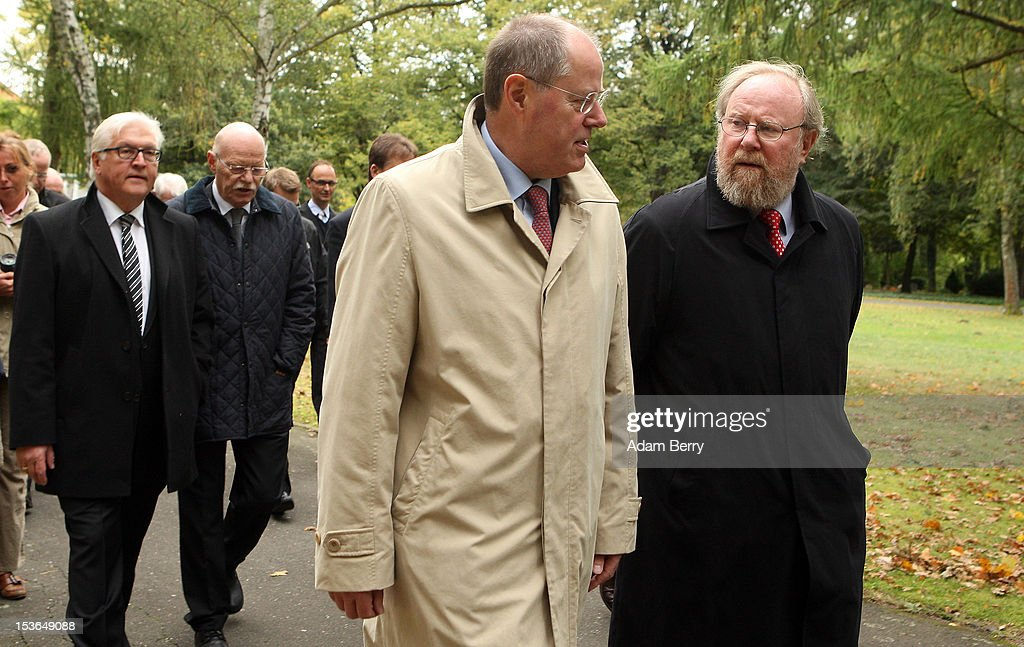 Peer Steinbrueck, former German federal finance minister and the German Social Democrat party's candidate for chancellor in the country's 2013 general elections (C), speaks to Wolfgang Thierse, vice-president of the Bundestag (R), in front of Frank-Walter Steinmeier, the German Social Democrat party's Bundestag faction leader (L), as they walk through a cemetery to visit the grave of Willy Brandt, former chancellor of the Federal Republic of Germany and Nobel Peace Prize winner, on October 8, 2012 in Berlin, Germany. Brandt was born on December 18, 1913 in Luebeck and died 20 years ago today. He led the SPD from 1964 to 1987 and was chancellor of West Germany from 1969 to 1974, a post from which he resigned after it was revealed that one of his closest aides worked as an agent of the East German secret service, or Stasi. For his efforts to achieve reconciliation between West Germany and the countries of the Soviet bloc, Brandt won the Nobel Prize for Peace in 1971.