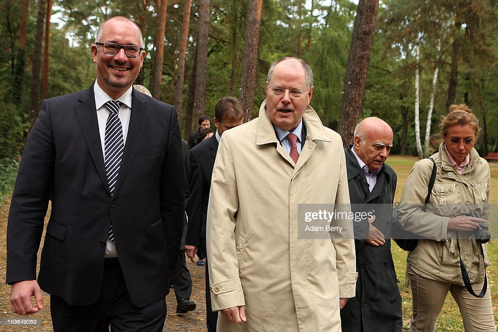 <a gi-track='captionPersonalityLinkClicked' href=/galleries/search?phrase=Peer+Steinbrueck&family=editorial&specificpeople=209110 ng-click='$event.stopPropagation()'>Peer Steinbrueck</a>, former German federal finance minister and the German Social Democrat party's candidate for chancellor in the country's 2013 general elections (C), and Jan Stoess, head of the German Social Democrat party in Berlin (L), walk through a cemetery to visit the grave of Willy Brandt, former chancellor of the Federal Republic of Germany and Nobel Peace Prize winner, on October 8, 2012 in Berlin, Germany. Brandt was born on December 18, 1913 in Luebeck and died 20 years ago today. He led the SPD from 1964 to 1987 and was chancellor of West Germany from 1969 to 1974, a post from which he resigned after it was revealed that one of his closest aides worked as an agent of the East German secret service, or Stasi. For his efforts to achieve reconciliation between West Germany and the countries of the Soviet bloc, Brandt won the Nobel Prize for Peace in 1971.