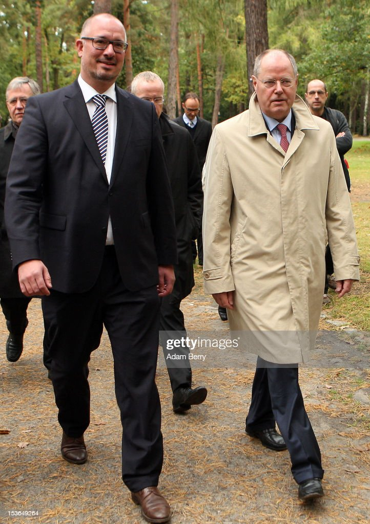 <a gi-track='captionPersonalityLinkClicked' href=/galleries/search?phrase=Peer+Steinbrueck&family=editorial&specificpeople=209110 ng-click='$event.stopPropagation()'>Peer Steinbrueck</a>, former German federal finance minister and the German Social Democrat party's candidate for chancellor in the country's 2013 general elections (R), and Jan Stoess, head of the German Social Democrat party in Berlin, walk through a cemetery to visit the grave of Willy Brandt, former chancellor of the Federal Republic of Germany and Nobel Peace Prize winner, on October 8, 2012 in Berlin, Germany. Brandt was born on December 18, 1913 in Luebeck and died 20 years ago today. He led the SPD from 1964 to 1987 and was chancellor of West Germany from 1969 to 1974, a post from which he resigned after it was revealed that one of his closest aides worked as an agent of the East German secret service, or Stasi. For his efforts to achieve reconciliation between West Germany and the countries of the Soviet bloc, Brandt won the Nobel Prize for Peace in 1971.