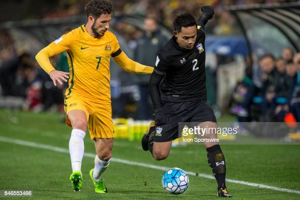Peerapat Notchaiya of the Thailand National Football Team and Mathew Leckie of the Australian National Football Team contest the ball during the FIFA...