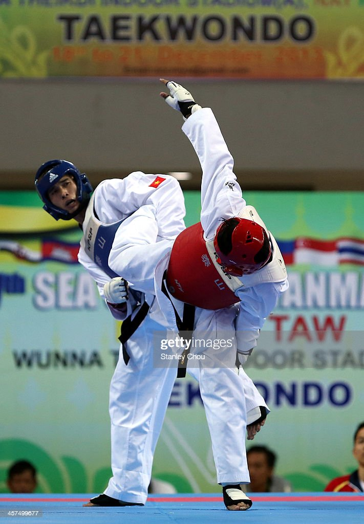 Peerathep Sila On of Thailand fights with Thanh Tam Duong of Vietnam during the Quarter Finals of the Men's 6874 kg TaeKwondo Competition during the...