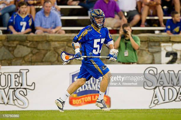 Peet Poillon of the Charlotte Hounds carries the ball up the field against the Boston Cannons at American Legion Memorial Stadium on June 15 2013 in...