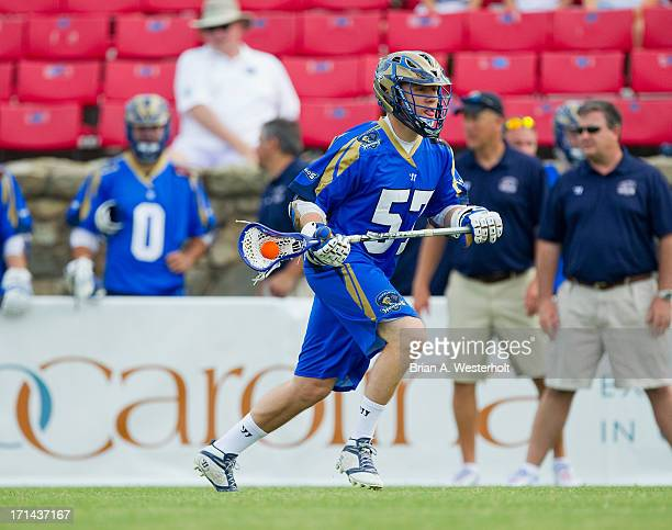Peet Poillon of the Charlotte Hounds carries the ball up the field against the Chesapeake Bayhawks at American Legion Memorial Stadium on June 22...