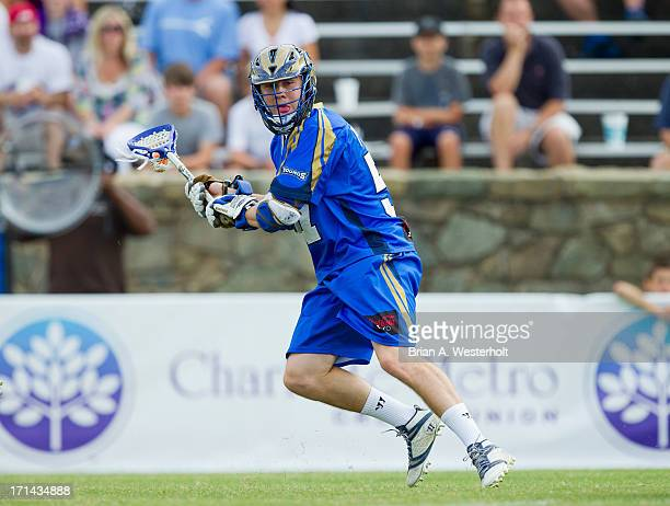 Peet Poillon of the Charlotte Hounds controls the ball against the Chesapeake Bayhawks at American Legion Memorial Stadium on June 22 2013 in...