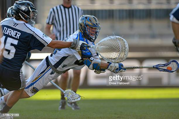 Peet Poillon of the Charlotte Hounds gets a diving shot off but does not score on Kip Turner of the Chesapeake Bayhawks during the MLL Championship...
