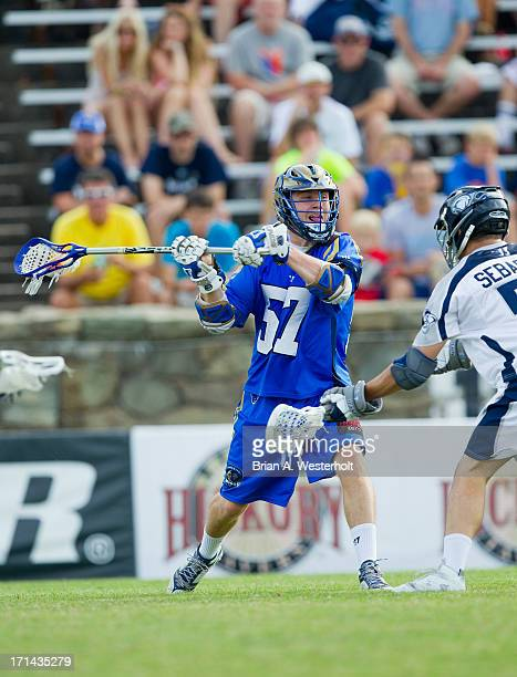 Peet Poillon of the Charlotte Hounds winds up to take a shot on goal against the Chesapeake Bayhawks at American Legion Memorial Stadium on June 22...