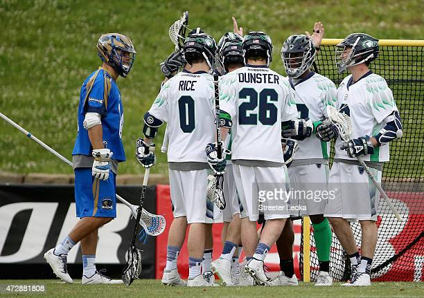 Peet Poillon of the Chesapeake Bayhawks celebrates with his teammates after scoring against the Charlotte Hounds during their game at American Legion...