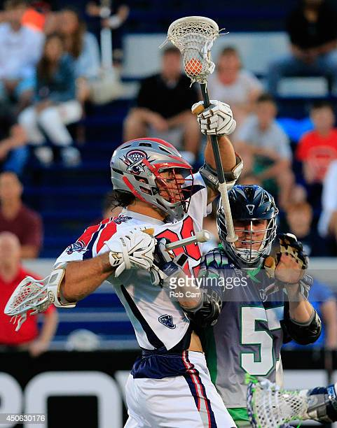 Peet Poillon of the Chesapeake Bayhawks defends against Paul Rabil of the Boston Cannons at NavyMarine Corps Memorial Stadium on June 14 2014 in...