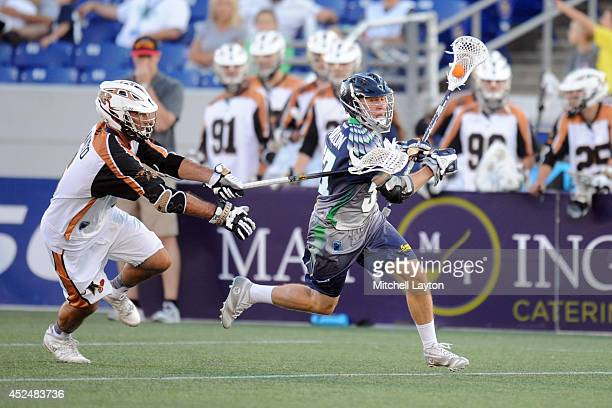 Peet Poillon of the Chesapeake Bayhawks runs with the ball with pressure form Stephen Ianzito of the Rochester Rattlers during a Major League...