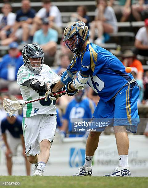Peet Poillon of the Chesapeake Bayhawks shoots against the Charlotte Hounds during their game at American Legion Memorial Stadium on May 10 2015 in...