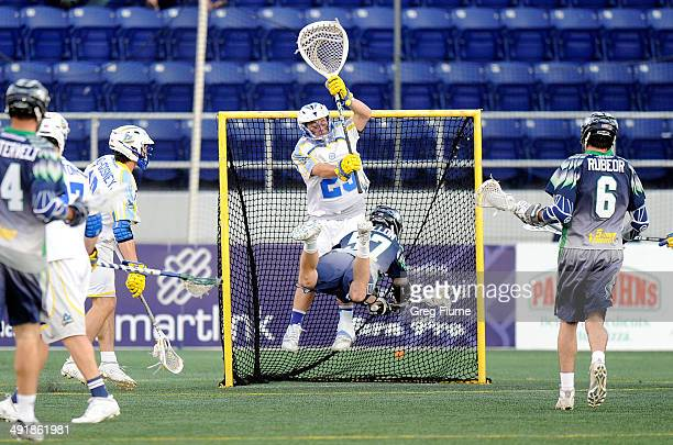 Peet Poillon of the Chesapeake Bayhawks shoots and scores in the second quarter against Brett Queener of the Florida Launch at NavyMarine Corps...