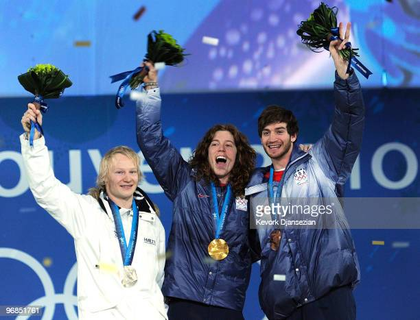 Peetu Piiroinen of Finland celebrates winning the Silver Shaun White of United States Gold and Scott Lago of United States Bronze during the medal...