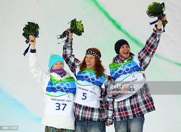 Peetu Piiroinen of Finland poses after winning the silver Shaun White of the United States poses after winning the gold and Scott Lago after winning...