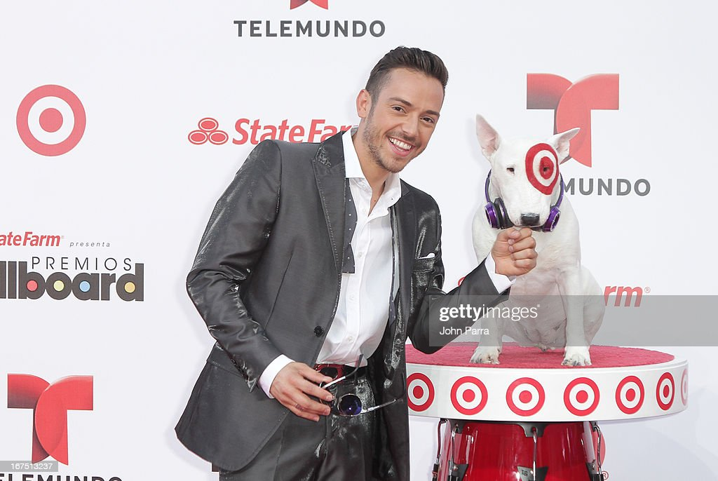 PeeWee celebrates with Bullseye, Target's Beloved Bull Terrier Mascot, at the 2013 Billboard Latin Music Awards at BankUnited Center on April 25, 2013 in Miami, Florida.