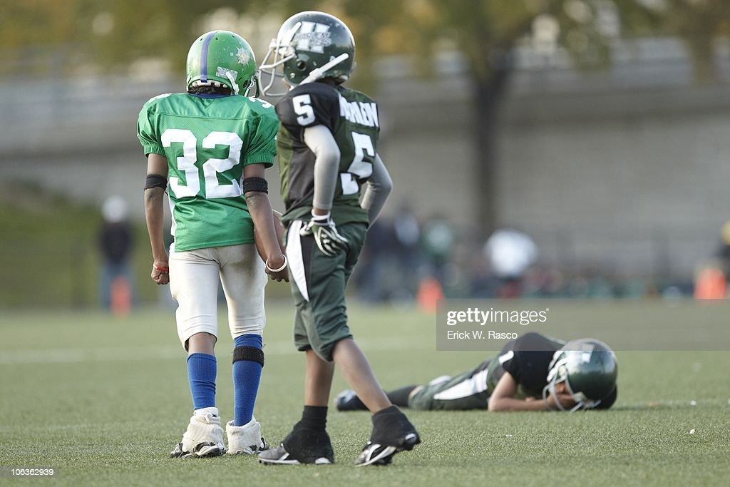 Harlem Jets player down on field after sustaining injury during game vs Mill Basin Mariners at Harlem River Park. New York, NY